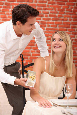 half length posed: Couple in a restaurant with a gift