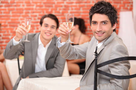 Boys with a glass of champagne photo
