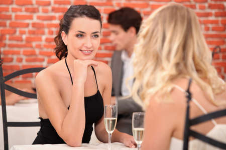 Two female friends having meal in posh restaurant photo