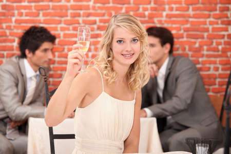 commend: Blond woman with champagne in restaurant