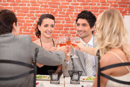 Friends having dinner together photo