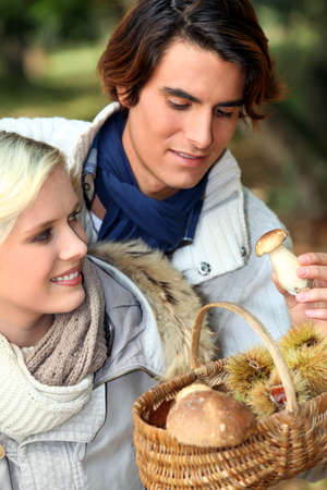 recompense: couple after mushroom picking Stock Photo