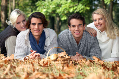 Adults lying in leaves photo