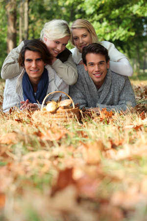 group of friends gathering mushrooms Stock Photo - 14111648