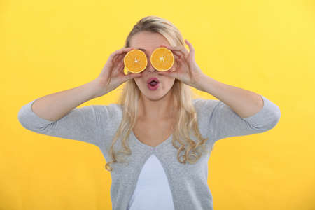 Woman with oranges for eyes photo