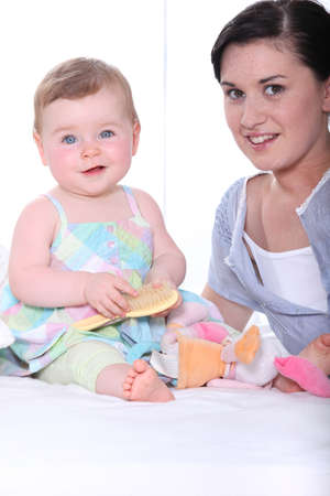 babysitting: Portrait of a young mum and baby girl Stock Photo