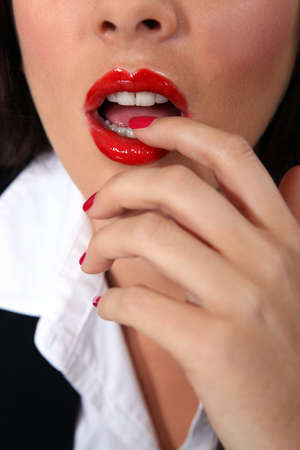 Businesswoman with red lips and nails photo