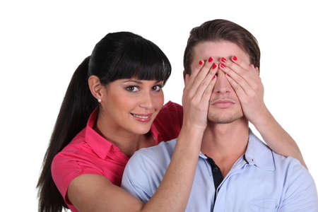 guess: Woman covering a mans eyes