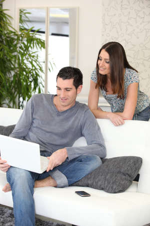 Couple at home looking at a laptop photo