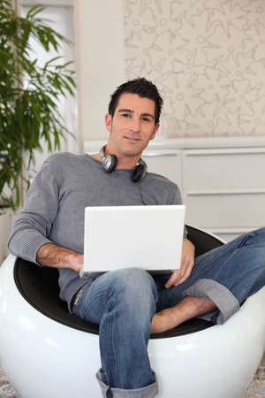 freak out: young man doing computer at home Stock Photo
