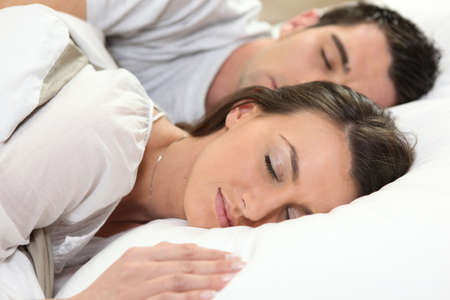 romance bed: couple sleeping together Stock Photo