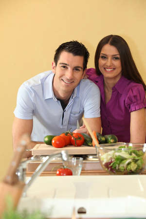 sexy food: Happy couple about to chop vegetables Stock Photo