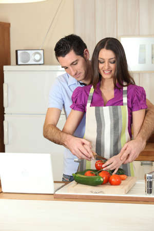 Man and woman preparing a meal together photo