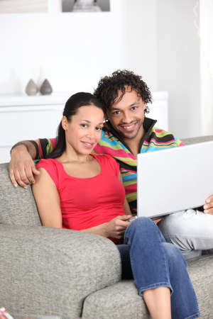 metis: Metis couple using laptop at home Stock Photo