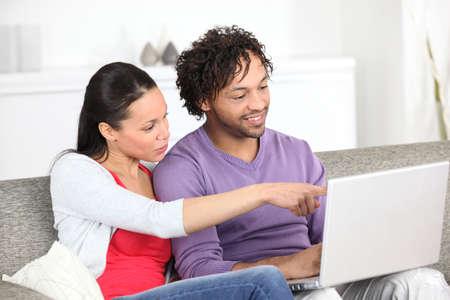 metis: Metis couple using laptop at home Stock Photo