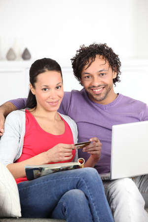 Couple makin purchase online photo
