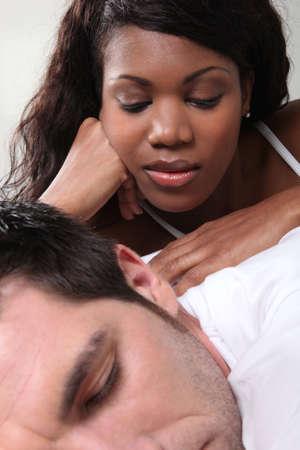 rubbing noses: Woman massaging her husband