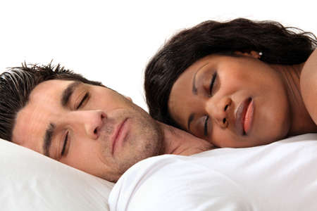 Woman sleeping on her husbands chest photo