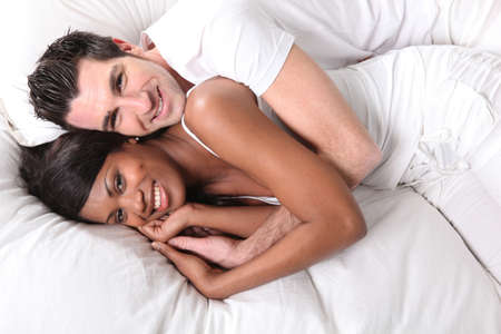 interracial couple on bed Stock Photo - 14103684
