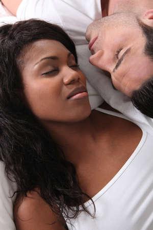 Couple asleep together photo