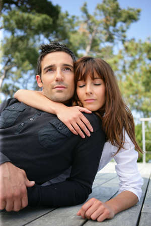 couple embracing outdoors photo