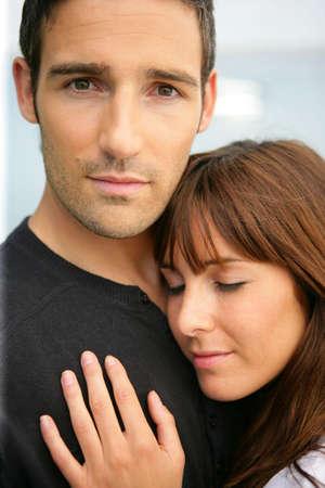 tender couple hugging photo