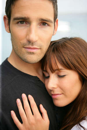 manly man: tender couple hugging Stock Photo