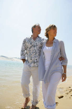Couple walking on the beach photo