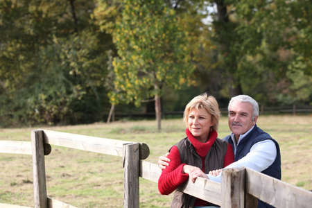 beauty farm: Couple by a paddock Stock Photo