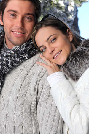 Couple wearing winter clothing photo