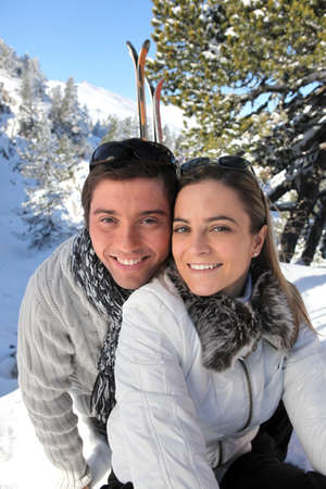 Couple skiing in the mountains photo
