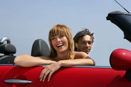 Woman riding in a convertible photo