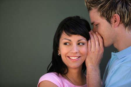 Couple whispering photo