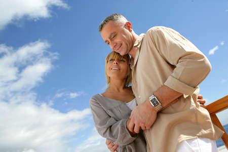 Couple stood on a balcony by the sea Stock Photo - 14102540