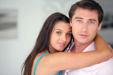 Young couple hugging photo