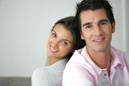 Young couple sitting back to back Stock Photo - 14102532