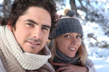Happy couple on winter walk photo