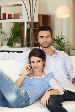 Couple relaxing on sofa photo