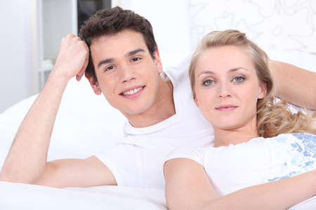 Happy couple laying in bed Stock Photo - 14102702