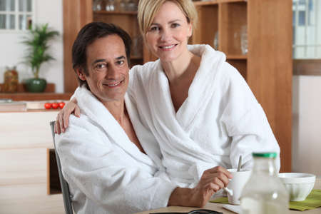 robes: Couple having breakfast in towelling robes