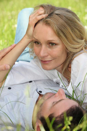 head rest: Couple lying on grass