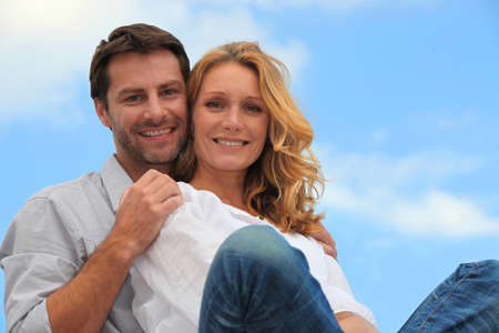 accomplices: couple in blue sky Stock Photo