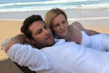 Couple lying on beach photo