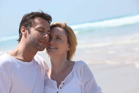 accomplices: couple on the beach