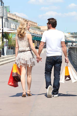 Couple shopping in the street photo