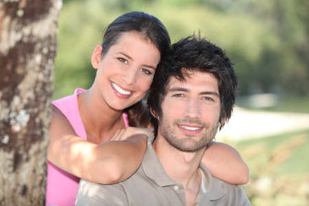 man woman hugging: portrait of a couple outdoors Stock Photo