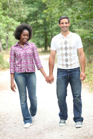 walk in: Couple walking in the woods