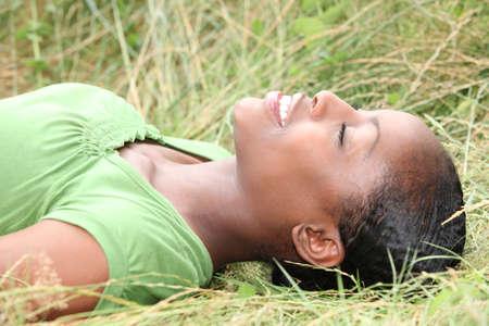 closed eye: Girl lying in the grass