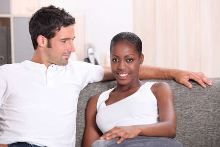 Young couple relaxing at home Stock Photo - 14104028