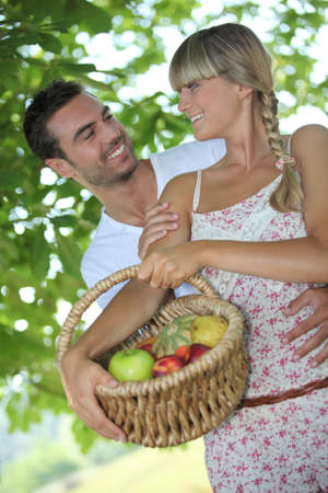 Couple with fruit basket photo